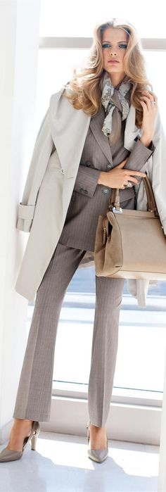 Monochromatic business outfit pairing neutral tones with assorted textures such as an artfully tied scarf, oversized light blazer, tailored pants, stilettos and a practical handbag.