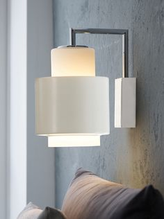 """Y1949 wall lamp mid century design, Denmark.  White opal glass with white metal sleeve option.  5.5"""" diameter X 9.8"""" high.  Comes with 78"""" cord for pin up but can be direct wired.  One E27 standard medium base bulb.  List $183."""