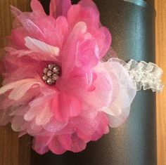White ruffled Headband accented with shades of pink oversized flower. Worn centered or to the side. Perfect addition to pictures! Perfect addition to Baby pictures!  by RockinRobinsBling, $6.00