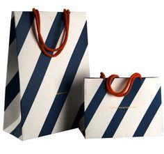 Title: Luxury retail carrier bags  Client: Construct for porto montenegro  Materials: Art paper.  Processes: Litho print, foil block, dye handles