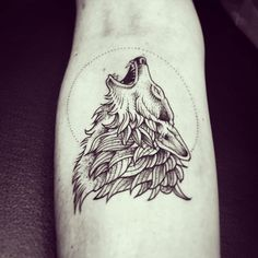 Howling wolf blackwork tattoo.