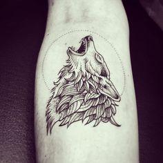 Howling wolf blackwork tattoo.