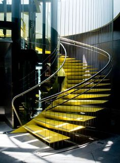 Large helical staircase has triangular stringers, cables and color. By Ronstan Architectural