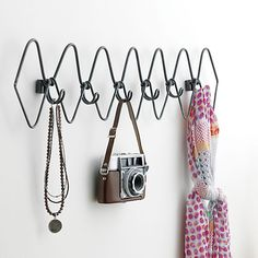 live wire.  Sculptural waves of handcrafted raw steel are coat rack occupied, wall art empty.  Six hooks are at the ready for jackets, bags, hats, scarves.  Multiples create an interesting effect. Handcrafted raw ironMounting hardware includedIndoor use onlyClean with damp clothMade in India.