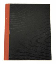 """A black notebook with notes in Monroe's hand. A large letter """"M"""" is drawn inside the front and back covers. There are multiple notes with ideas for a """"Street Car Scene"""" - """"begin with ? (1st grade happening Mexican boy accuses me of hurting him - having to stay after school it was nite [sic] outside - have place - concern because of Stan K. accusations plus - getting dress for Mitch trying to look nice especially since what Stan K. has said."""""""