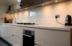 Brighten your kitchen with glass worktops! http://www.blog.sprayedsplashbacks.co.uk/cheap-kitchen-worktops/