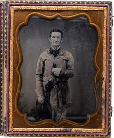 """[Texas Ranger]. John S. """"Rip"""" Ford Half-Plate Ambrotype, circa 1858.  This portrait features the legendary Texas Ranger at the apex of his career, likely May 1858, near the time of the Antelope Hills Campaign. Ford's fringed buckskin coat, gauntlets, and flap revolver holsters appear well worn. In his right hand he holds a flat-brimmed, high-crowned hat. The holstered revolvers appear to be a Colt Dragoon and a Colt Walker, which weighed almost ten pounds together. (via Heritage Auctions)"""