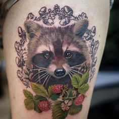 Raccoon with berries color tattoo