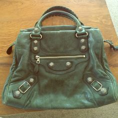 Balenciaga RARE Giant City in dk green 2009 Balenciaga dk green giant city with silver giant hardware. Purchased at Barneys New York.  Giant hardware has been discontinued! Wear at bottom (see photo). Gorgeous green color. Comes with mirror but no dust bag. Balenciaga Bags Shoulder Bags