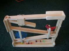 Single Marble Roller. Handcrafted from solid Pine wood. Sure to become a favorite toy! www.clfstore.com