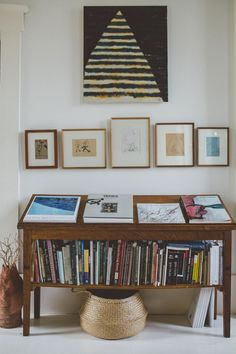 Trend Alert: 11 Periodical-Style Shelves for Design Book Lovers - Remodelista : Art books on a freestanding shelf mirror the hanging artwork in photographer Erin Little's home in a converted church. Photograph courtesy of Erin Little. Cottage Kitchen Cabinets, Kitchen Cabinet Design, Modern Kitchen Design, Semarang, Layout Design, Home Living Room, Living Spaces, Traditional Bookshelves, Sweet Home