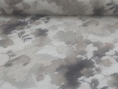 Composizione: 65% #Cotone 35% poliestere #Tessuto per #tovagliato sfondo ecru con #fiori e foglie stilizzati nelle diverse sfumature #tortora. Con un delicato effetto sfumato, questo tessuto dona eleganza e stile ad ogni #tavola.