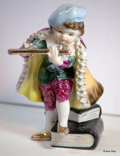 Antique vintage porcelain playing boy figurine Limited Edition 52/85