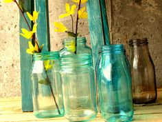Craftberry Bush: Mason Blue Glass Canning Jar DIY stain any type of jar using modge podge and food coloring. I have loads of mason jars that I would like to re-purpose. Dye Mason Jars, Tinted Mason Jars, Colored Mason Jars, Mason Jar Diy, Colored Glass, Bottles And Jars, Glass Bottles, Cut Bottles, Recycling