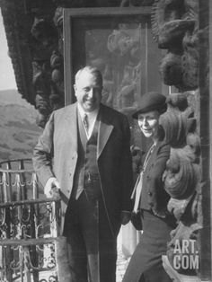 Publisher William Randolph Hearst and Visitor Mrs. Burton Holmes on Balcony of Ranch House Premium Photographic Print by William Davis at Art.com