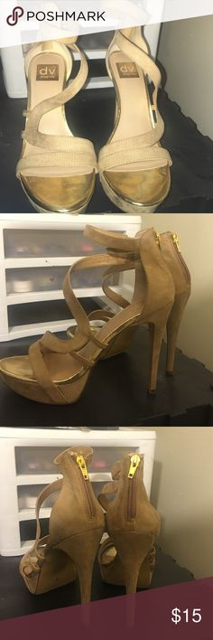 Dolce Vita high platform high heels Very comfy 5 inch heel ( I'm guessing 5) but they are easy to walk in .. They are tan and gold .. I bought from Nordstrom and were them 1 time Dolce Vita Shoes Heels