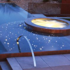 A unique idea from a pool designer. Led's imbedded into the beach area of the pool look like shining stars in the night sky reflecting on the water.