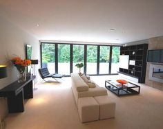 Photo Of Contemporary Beige White Living Room Lounge With Built In Fire  Sliding Folding Doors