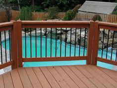Deck Wrought Iron Deck Railing  100s of Deck Railing Ideas http://awoodrailing.com/2014/11/16/100s-of-deck-railing-ideas-designs/