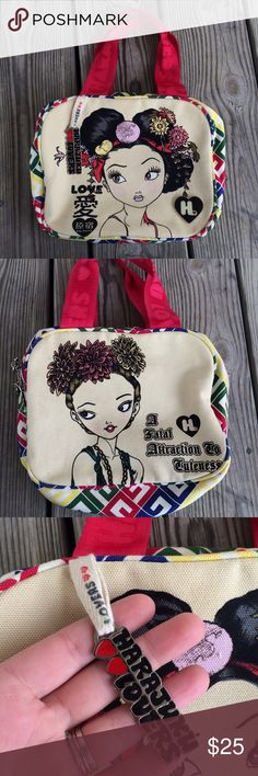 Harajuku Lovers Hand Bag Tote Cute bag from Harajuku Lovers. Like new condition. Different designs on each side with metal charm. Cloth // canvas material. Harajuku Lovers Bags Totes