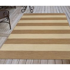 Simple, wide stripes of dark tan and beige highlight the fresh, but neutral pattern on this Sand and Sisal Striped Rug. Large stripes combine with sophistication to create this indoor-outdoor flat weave, reversible rug. Room Rugs, Area Rugs, Beige Highlights, Clearance Rugs, Striped Rug, Wide Stripes, Dark Tan, Rug Cleaning, Sisal