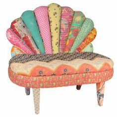 "One-of-a-kind peacock chair with a mango wood frame and vintage kantha upholstery.   Product: ChairConstruction Material: Vintage kantha upholstery and mango woodColor: MultiFeatures: One-of-a-kindDimensions: 28"" H x 42"" W x 12"" D"