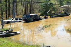 Soldiers assigned to the Louisiana National Guard, use a bridge erection boat to assist residents impacted by recent flooding near Ponchatoula, La.  U.S. Army photo courtesy of National Guard