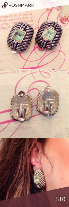 """Vintage Peridot and Silver Clip Earrings Vintage antique silver tone earrings with peridot colored stones. A little heavy. Measures 1"""" x 3/4"""". Excellent condition. Jewelry Earrings"""