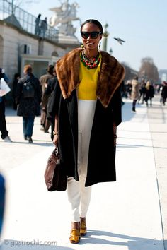 love this vintage (inspired?) fur trimmed coat. love pops of color.