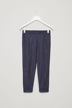 COS image 5 of Relaxed pleated trousers in Indigo