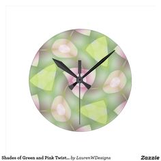 Shades of Green and Pink Twisted Geometrics Round Wallclocks This geometric design features twisted circles and triangles with shades of green and pink. There's a lot of movement in this design!