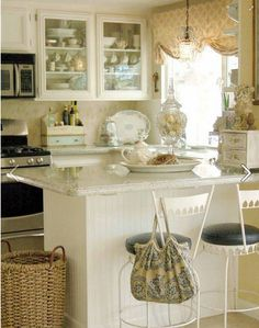 White kitchen design, glass doors