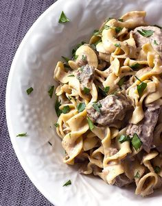 Crock Pot Beef Stroganoff is serious comfort food. Tender beef, mushrooms, and onions are cooked in a slow cooker and mixed with a sour cream sauce and egg noodles.