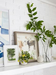 The owners of this New York house scoured Etsy and eBay for vintage prints and paintings to lean above the mantel, including this secondhand watercolor of cows.