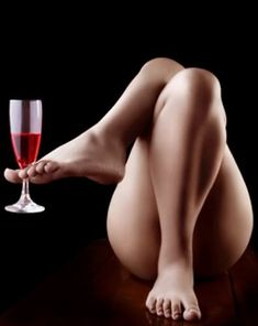 "How did THIS even come up as a photo shoot idea?! ""Oh hey..how about nude and holding a glass of wine between your toes??"" No. JUST NO."