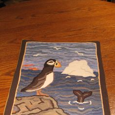 Puffin, whale tail and iceberg: Lillian Dwyer's hooked rugs, Tilting