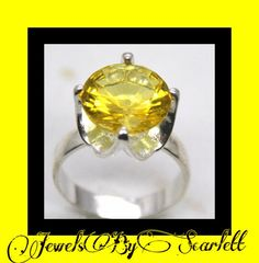 #Incredible lemon yellow #citrine solitaire ring. Perfect addition to any woman's collection.   Shop this product here: http://spreesy.com/JewelsByScarlett/161   Shop all of our products at http://spreesy.com/JewelsByScarlett      Pinterest selling powered by Spreesy.com