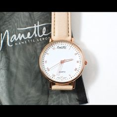 BN Nanette Lepore Classic Rose Gold Watch Nanette Nanette Lepore Classic Rose Gold Watch ($55) – Nanette Lepore is launching her new watch category this month called Nanette Nanette Lepore and partnered with POPSUGAR to create an exclusive design as a first look into the new collection. Watch for this new collection on Bloomingdales.com later this month. This watch has a beige vegan leather strap and a white enamel dial with rose gold roman numerals, hands and face. Battery included. Nanette…