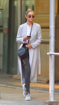 Sporting a simple athleisure look paired with a Rag & Bone handbag in New York City.   - HarpersBAZAAR.com