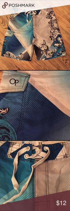 Ocean Pacific swim board short Men's swim board short has a side cargo pocket for you wallet or phone. Velcro fly front with tie closure. Get ready for summer!! ocean Pacific Swim Board Shorts