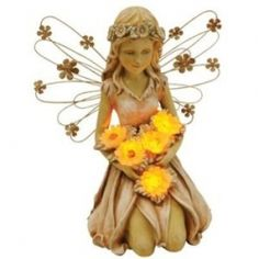 CCI Moonrays 91332 Solar Power highlighted fairy with sunflowers, This garden accent combines multiple design materials - polyresin and metal - to create a charming effect. The sunflowers that she holds glow at night to light up her beautiful detail.
