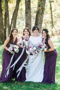 Gorgeous bridesmaids in long, dark purple dresses!  Such an elegant look and love it with all of their dark hair! Taken at THE SPRINGS in Rockwall, Poetry Hall.  Book your free tour today! Photographer:  Reyna Photography #bridesmaids #purplewedding #purplebridesmaids #bridesmaidsinpurple #bridesmaiddresses