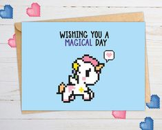 """The world can be a cruel and devastating place sometimes... Well, and sometimes it just feels like you're walking down a gummy bear road filled with marshmallows and unicorns who poop rainbows. We'd like to focus on the rainbow side of things and that's why we're now proudly presenting our geeky """"WISHING YOU A MAGICAL DAY"""" unicorn greeting card. Check out our little to show your special someone why you wouldn't want to share your gummy bears with anyone else!"""