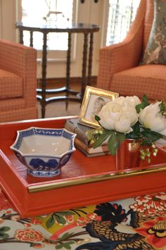 Look how pretty this HomeGoods tray looks on this big ottoman. It can now function as a coffee table and an ottoman!