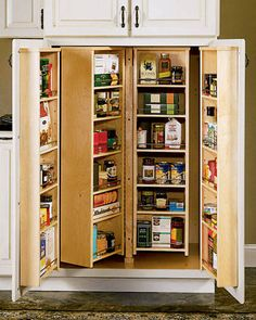 """Find a storage powerhouse behind closed doors with height-adjustable shelves that rotate around a central pole. """"People end up keeping food for too long because it's out of sight,"""" says Connie Edwards, design director for American Woodmark. """"If you have to look at something every day, and you're not using it, you'll get rid of it."""" For maximum organization, dedicate each shelf to a different kind of food.   - ELLEDecor.com"""