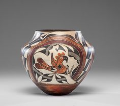 Native American Historic Acoma Poly chrome Pottery Olla 387. Description: Acoma Poly chrome Olla, design incorporates parrots perched on foliage and are surroun