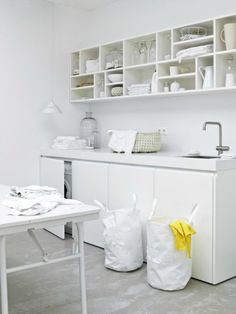 Steal This Look: The Clean White Laundry Room (Remodelista: Sourcebook for the Considered Home) White Laundry Rooms, Laundry In Bathroom, Small Laundry, Ikea Laundry, Hidden Laundry, Laundry Shelves, Cubby Shelves, Shelf, Laundry Room Organization