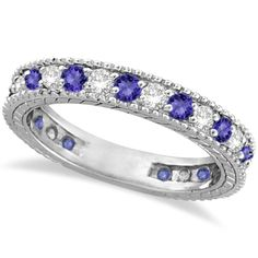 12 natural Tanzanites and 12 brilliant-cut round diamonds are alternating and are circling almost all the way around this designer vintage style eternity band. The milgrain edges and the filigree scroll work design add the ultimate designer's touch to this lady's antique style gemstone ring. <p>Wear this color gemstone ring as an anniversary ring, as a modern wedding band, as a mother's ring, as a right hand fashion ring, or stack it with our other stacking rings.