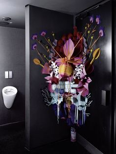 Showing the power of the aerosol can and how it can make a dirty bathroom smell like pretty flowers.