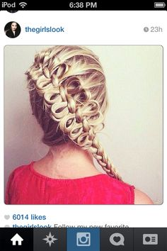 Okay, this could also be a dragonfly braid I guess, or you could make up a name for it:) i believe its a French braid with pieces pulled loose or it's a French with a bunch of hair bows made on it